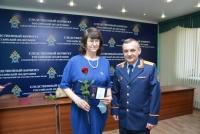 Доцент ЧИ БГУ Е.А. Скобина награждена памятной медалью Следственного комитета